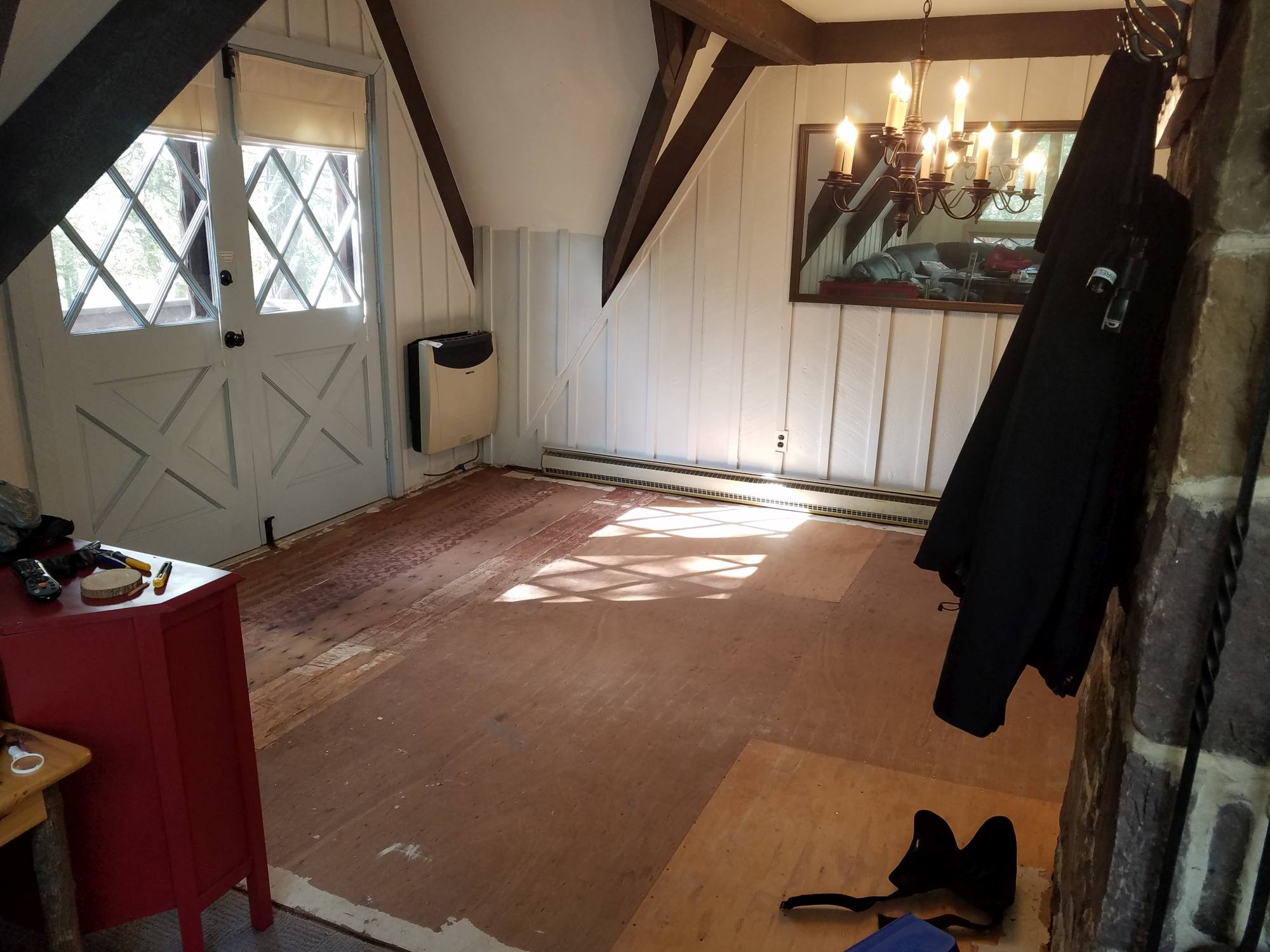 DIY Farmhouse Wide Plank Floor Made From Plywood - The Dining Room Subfloor With Staples Removed