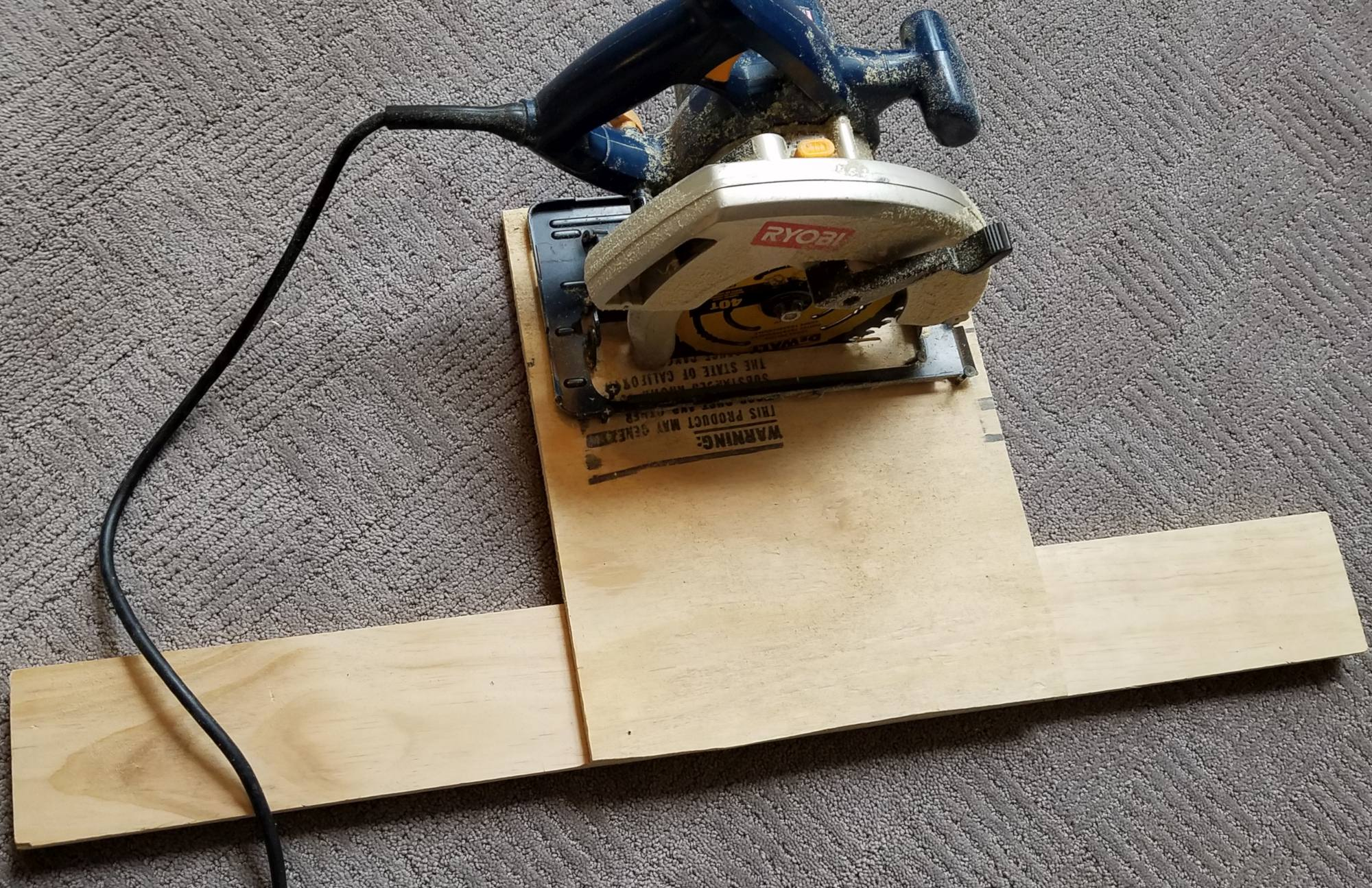 DIY Rustic Wide Plank Plywood Flooring - Secure The Jig To The Circular Saw Using Screws