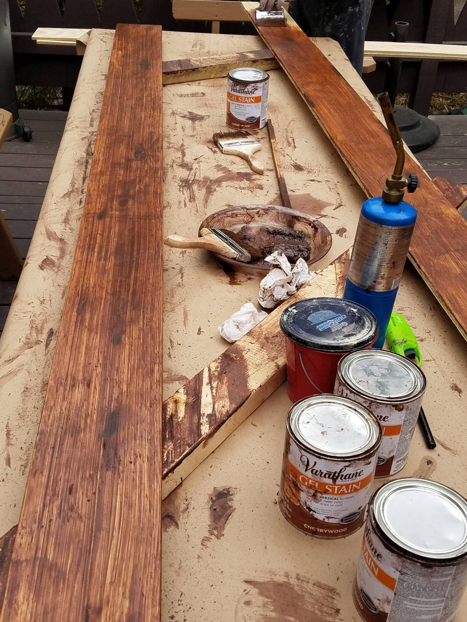 DIY Farmhouse Wide Plank Flooring Made From Plywood - Applying Gel Stain and distressing to the wide plank plywood floor boards